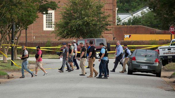 PHOTO: Police work the scene where eleven people were killed during a mass shooting at the Virginia Beach city public works building, May 31, 2019 in Virginia Beach, Va. (L. Todd Spencer/The Virginian-Pilot via AP)