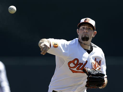 Baltimore Orioles starting pitcher Jason Hammel throws a pitch during a spring training baseball game against the Toronto Blue Jays, Thursday, March 7, 2013, in Sarasota, Fla. (AP Photo/Charlie Neibergall)