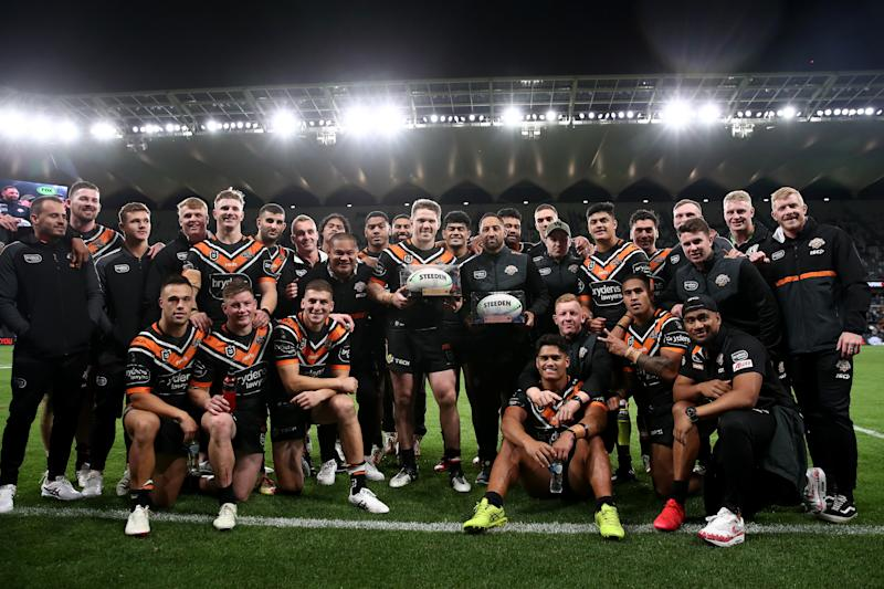Chris Lawrence and Benji Marshall pose with team mates after playing their last game for the Tigers.