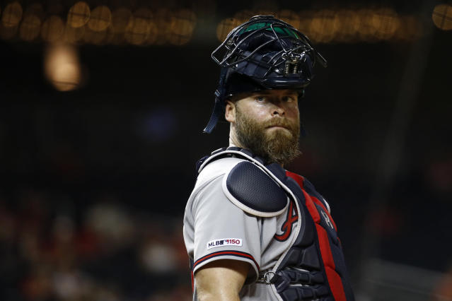 Atlanta Braves catcher Brian McCann stands behind home plate during a baseball game against the Washington Nationals, Tuesday, July 30, 2019, in Washington. (AP)