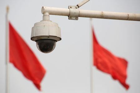 FILE PHOTO: Red flags fly near a security camera on Beijing's Tiananmen Square