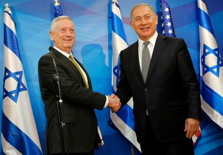 Israeli Prime Minister Benjamin Netanyahu (R) shakes hands with US Defence Secretary Jim Mattis before their meeting in Jerusalem on April 21, 2017