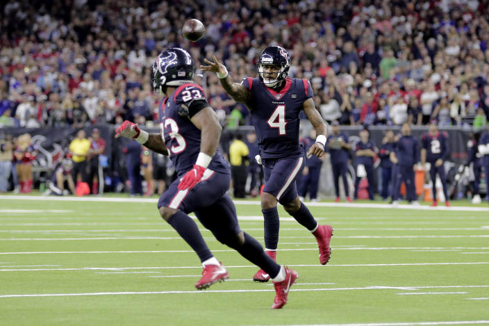 Houston Texans quarterback Deshaun Watson (4) throws a touchdown pass to running back Carlos Hyde (23) during the second half of an NFL wild-card playoff football game Saturday, Jan. 4, 2020, in Houston. The Texans won 22-19 in overtime.(AP Photo/Mike Marshall)