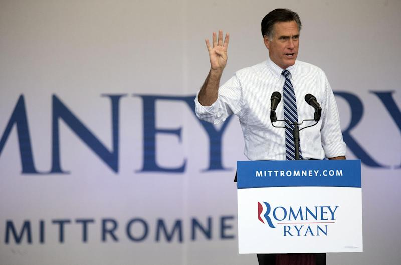 FILE - In this Oct. 23, 2012, file photo, Republican presidential candidate, former Massachusetts Gov. Mitt Romney speaks to a crowd of supporters during a rally in Henderson, Nev., as he holds up 4 fingers and asks if they want 4 more years of a bad economy. No region in America has seen more presidential campaign commercials. Last week alone, Romney's campaign and its allies spent $3.6 million on Nevada commercials, while President Barack Obama and his supporters spent $2.7 million. (AP Photo/Julie Jacobson, File)