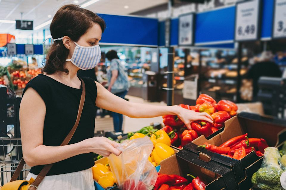 Woman in grocery shopping during COVID-19. Credit: Getty.