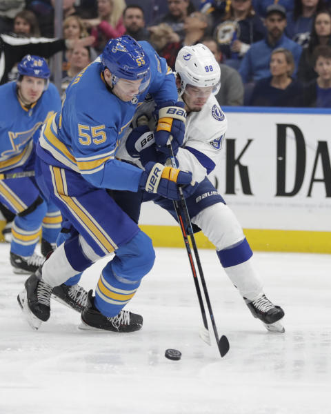 St. Louis Blues' Colton Parayko (55) battles Tampa Bay Lightning's Mikhail Sergachev (98) for the puck in the second period of an NHL hockey game, Saturday, March 23, 2019, in St. Louis. (AP Photo/Tom Gannam)