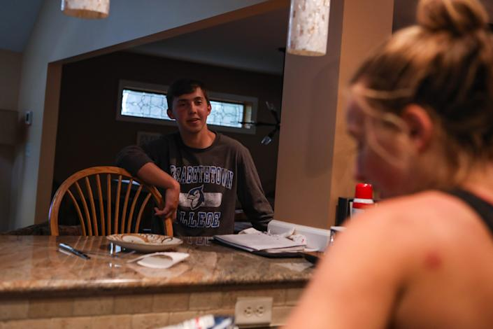 Will Rhodunda chats with his sister Alexa in their Wilmington, Del., home June 12.