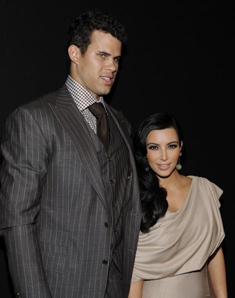 FILE - In this Aug. 31, 2011 file photo, newlyweds Kim Kardashian and Kris Humphries attend a party thrown in their honor at Capitale in New York. Attorneys for Kardashian and Humphries are due in a Los Angeles courtroom on Friday, Feb. 15, 2013 to argue over a trial date to end the couple's 72-day marriage. Humphries is seeking to delay the case until after the NBA season is over, while Kardashian wants the marriage ended as soon as possible. (AP Photo/Evan Agostini, File)