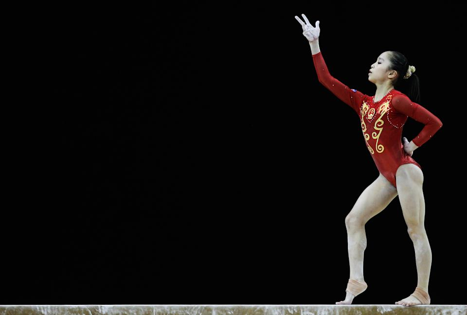 China's 17-year-old Yao Jinnan in action on the balance beam during the Women's Artistic Gymnastics Olympic Qualification round at North Greenwich Arena on January 11, 2012 in London, England. (Paul Gilham/Getty Images)