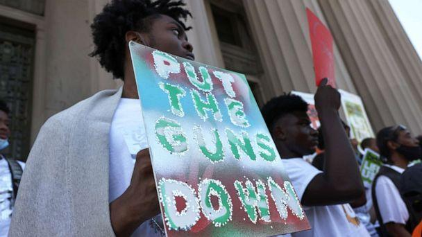 PHOTO: NEW YORK, NEW YORK - JULY 19: People gather at the 'Stand Up Against Gun Violence' rally at Bronx Borough Hall on July 19, 2021 in South Bronx in New York City.  (Michael M. Santiago/Getty Images)