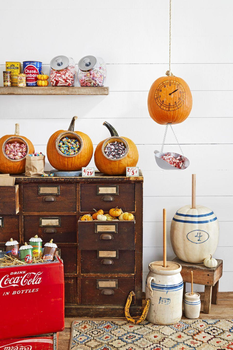 """<p>Based on a ceramic butter churn, this pumpkin with add lots of country charm to your porch.<br><strong><br>Make the pumpkin: </strong>Remove the stem from a large white pumpkin.<br>Draw a vintage-looking number and an oval around it on the front of the pumpkin with a pencil. Attach blue twine over drawing with hot-glue. Create two stripes on the top of the pumpkin with blue<br>washi tape. Glue a 1"""" dowel where the stem was.<br></p>"""