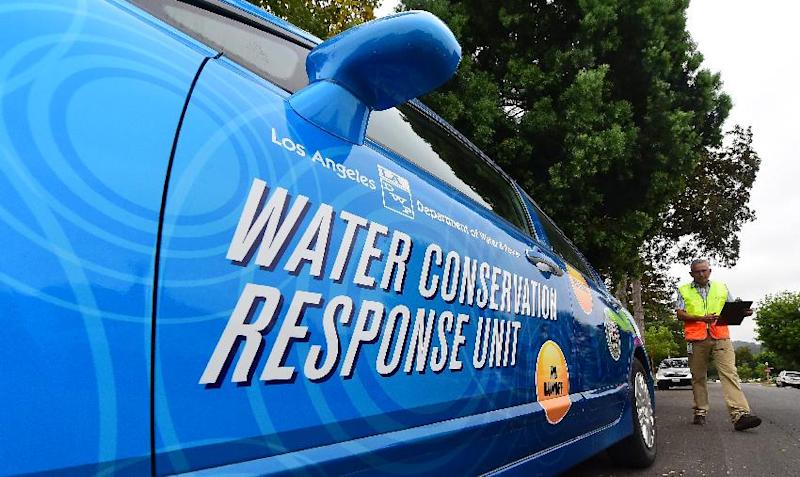 "Enrique Silva, a ""water policeman"" with the Water Conversation Response Unit in Los Angeles, returns to his vehicle after inspecting a neighborhood in Studio City, California on August 19, 2014"