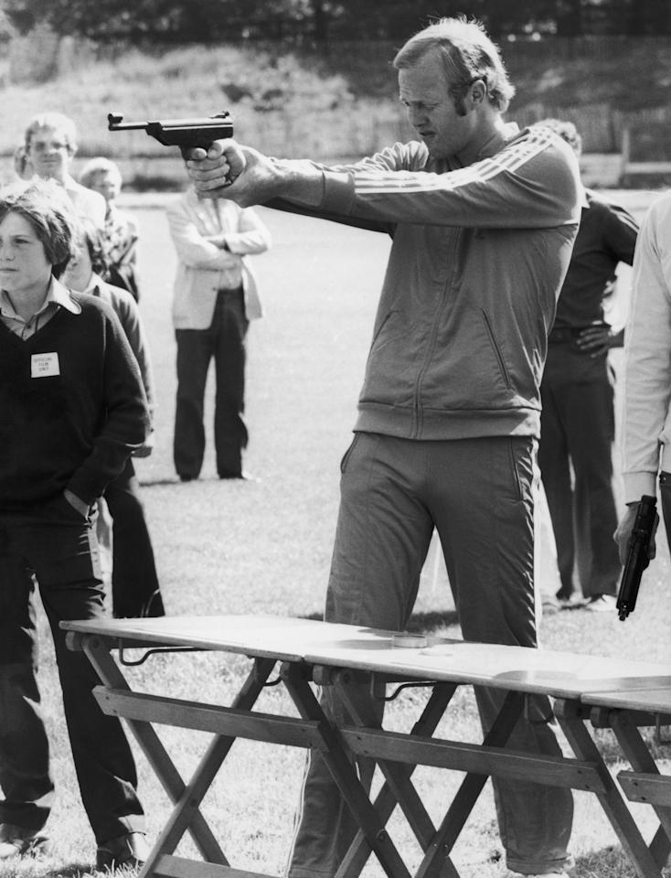 England cricket vice-captain Tony Greig takes aim in the target-shooting event on the 'Superstars' television programme, 22nd July 1974. The programme aimed to find the best all-round sportsman in a variety of fields. Greig went on to win the competition. (Photo by David Ashdown/Keystone/Hulton Archive/Getty Images)