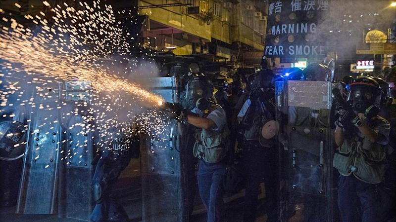 Hong Kong officers have again clashed with protesters after some pointed lasers at a police station