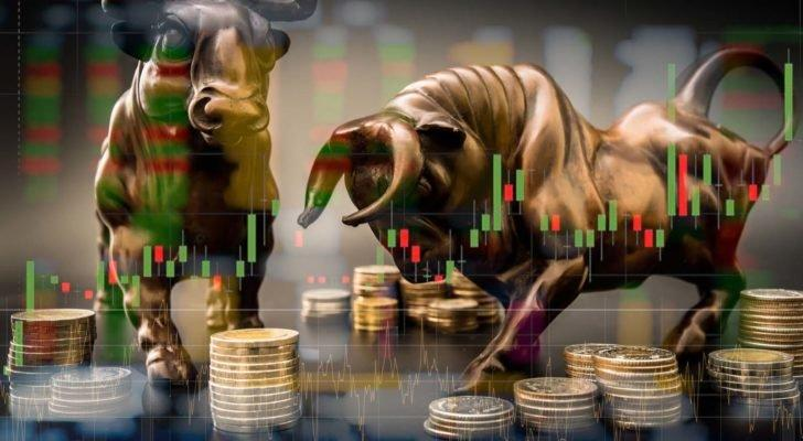 A digital image of a bronze bull and bear overlaid with a technical chart and images of coins.