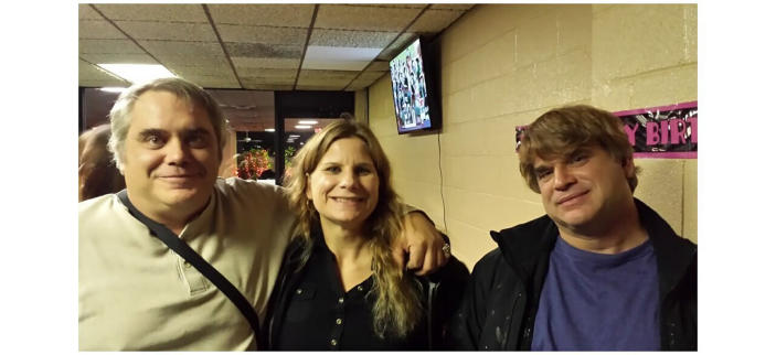 This October 2015 photo provided by John Michels, left, shows his brother Paul Andre Michels, right, posing with his sister Sarah Michels and himself, in Allen Park, Michigan. Paul Michels was among eight people killed March 16, 2021, in shootings at three Georgia massage parlors in the Atlanta area. (John Michels via AP)