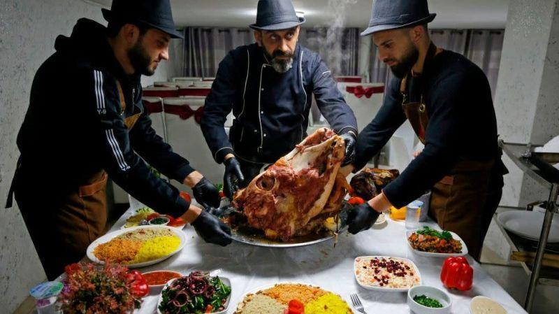 Palestinian chefs in Hebron serve a traditional meal of sheep's head