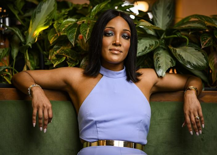 Mickey Guyton poses for a portrait at the at the Stateside Kitchen at Dream Nashville.
