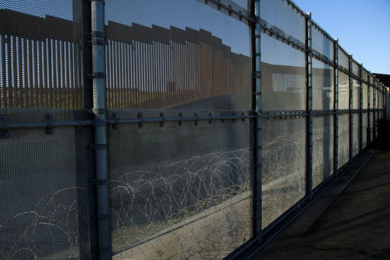 Biden has ordered a halt to new construction of the controversial border wall, seen here in San Diego, California
