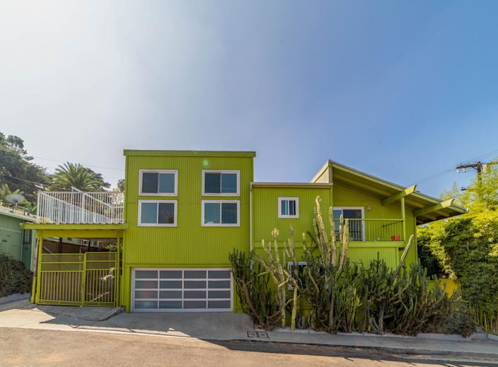"<div class=""caption""> Beyond the fabulous avocado-olive-lime-green exterior, this home settled in the hills of Echo Park, Los Angeles, is full of delights. The primary bedroom has a walk-in closet and a balcony; one of the rooms has a little loft accessible by a ladder, and there's even a tucked-away rooftop deck. </div>"