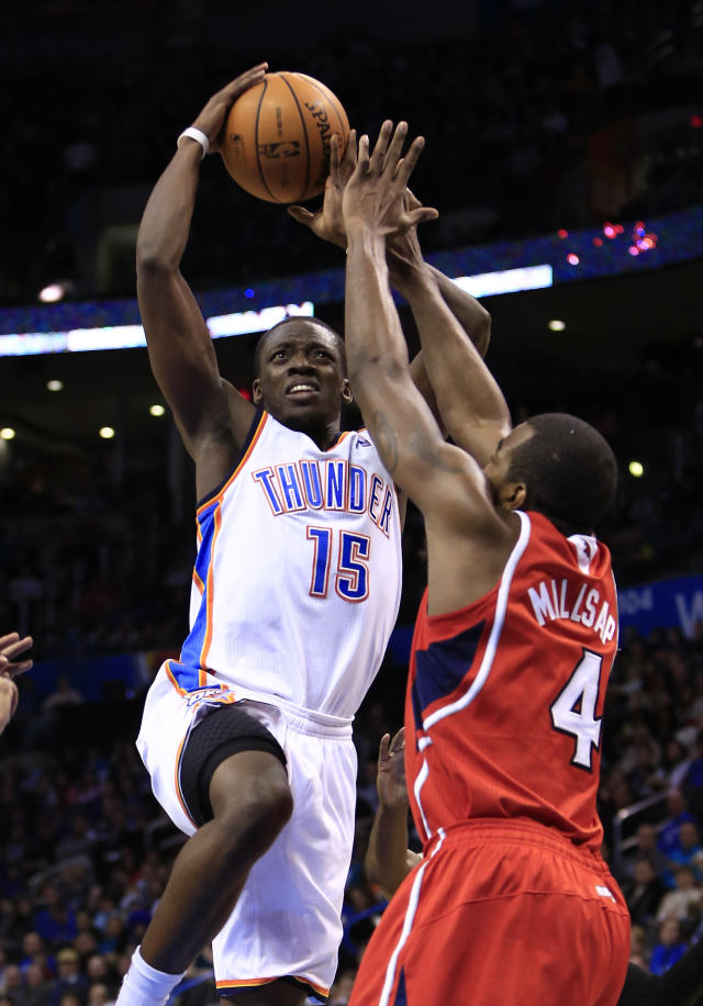 FILE - In this Jan. 27, 2014, file photo, Oklahoma City Thunder point guard Reggie Jackson (15) shoots over Atlanta Hawks power forward Paul Millsap (4) during the second half of an NBA basketball game in Oklahoma City. Jackson has stepped in for the injured Russell Westbrook and the Thunder have continued to roll. Thunder coach Scott Brooks says Jackson's improvement is not always evident, and not because of Kevin Durant's MVP play. Brooks says it's hard for Jackson to standout against the talented point guards he faces in the Western Conference on nightly basis. (AP Photo/Alonzo Adams, File)