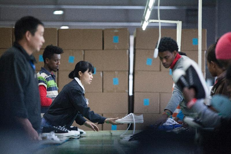 Ethiopian and Chinese workers inside the Huajian factory, a company that  makes shoes for the