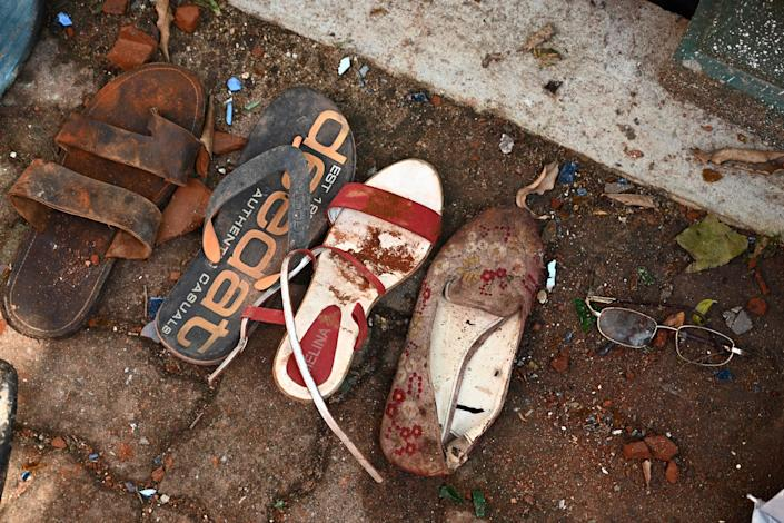 Shoes and belongings of victims are collected as evidence at St Sebastian's Church in Negombo on April 22, 2019, a day after the church was hit in series of bomb blasts targeting churches and luxury hotels in Sri Lanka. (Photo: Jewel Samad/AFP/Getty Images)