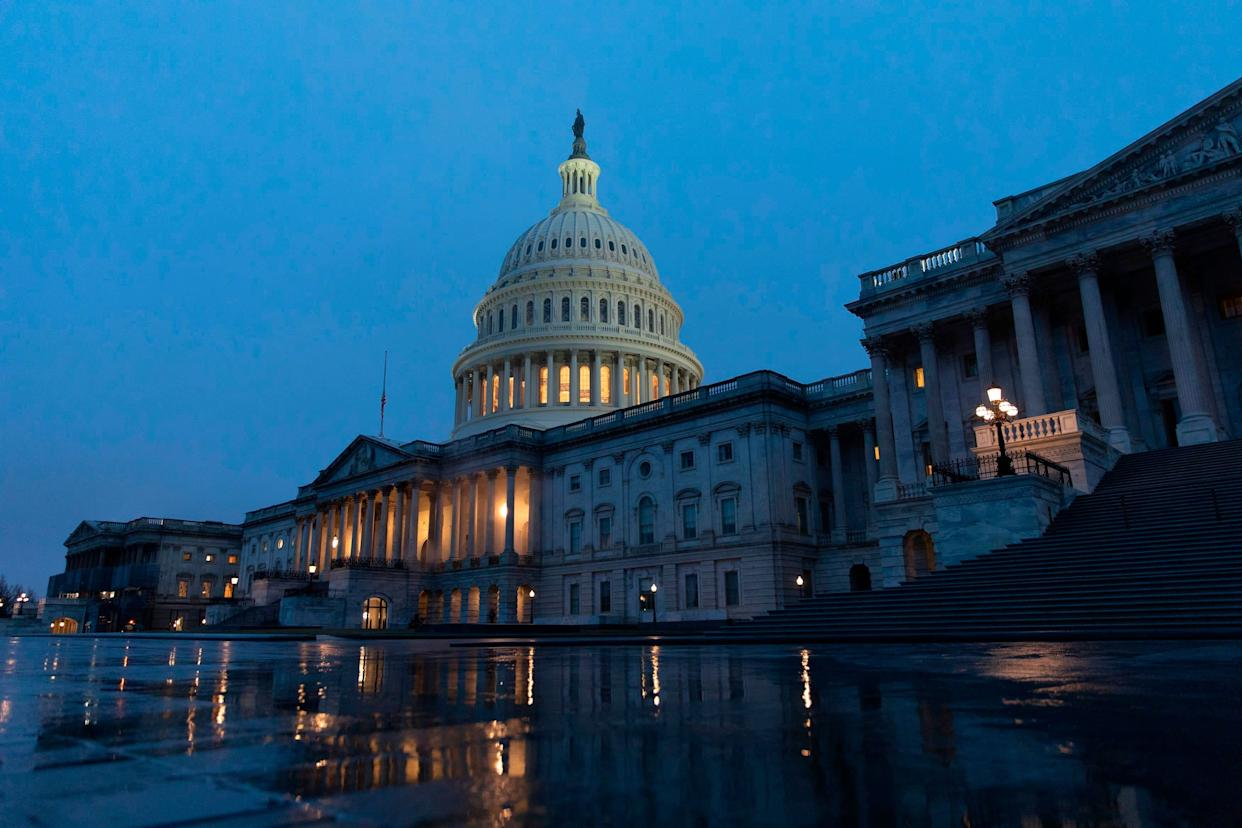 The U.S. flag flies at half-staff in front of the U.S. Capitol in tribute to former President George H.W. Bush, early on Dec. 2, 2018, in Washington, D.C. (Photo: ALEX EDELMAN via Getty Images)