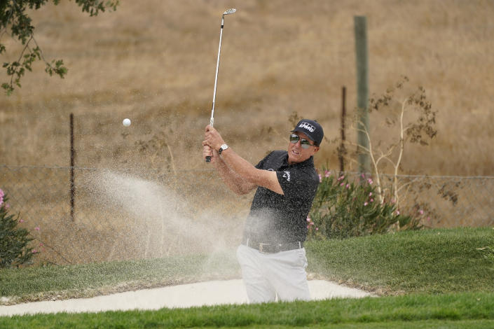 Phil Mickelson hits out of a bunker onto the third green during the first round of the Fortinet Championship PGA golf tournament, Thursday, Sept. 16, 2021, at the Silverado Resort North Course in Napa, Calif. (AP Photo/Eric Risberg)