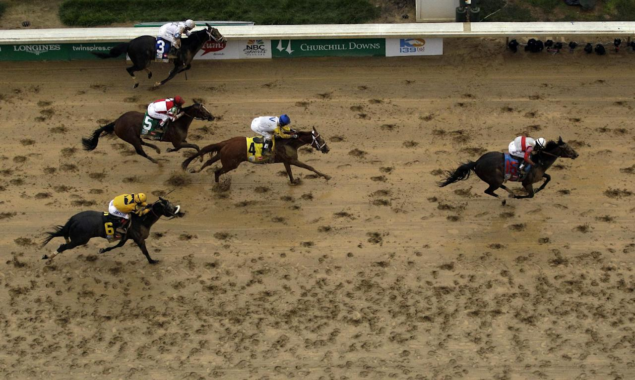 Joel Rosario rides Orb to a victory in the 139th Kentucky Derby at Churchill Downs Saturday, May 4, 2013, in Louisville, Ky. (AP Photo/Charlie Riedel)