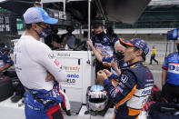 Takuma Sato, right, of Japan, walks with Graham Rahal during practice for the Indianapolis 500 auto race at Indianapolis Motor Speedway, Friday, May 21, 2021, in Indianapolis. (AP Photo/Darron Cummings)