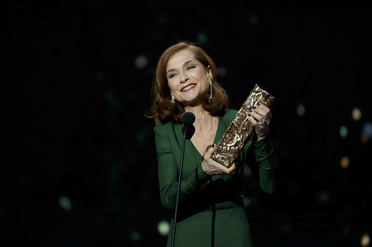"Actress Isabelle Huppert reacts on stage as she receives the Best Actress Award for her role in the film ""Elle"" at the 42nd Cesar Awards ceremony in Paris, France, February 24, 2017.        REUTERS/Philippe Wojazer  TPX IMAGES OF THE DAY"