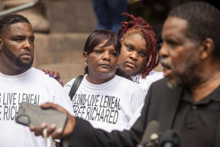 Jacqueline Jackson Frazier, mother of Leneal Frazier, center, holds onto her son Anthony Frazier, left, during a news conference outside of City Hall, Friday, July 9, 2021, in Minneapolis. Leneal Frazier was killed earlier in the week after his vehicle was struck by a squad car that police said was pursuing another driver linked to several robberies. Frazier was not involved in the pursuit. (Antranik Tavitian/Star Tribune via AP)