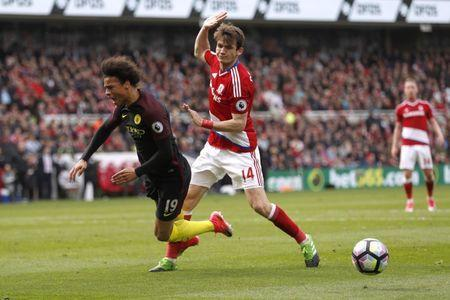 Britain Football Soccer - Middlesbrough v Manchester City - Premier League - The Riverside Stadium - 30/4/17 Middlesbrough's Marten De Roon concedes a penalty against Manchester City's Leroy Sane Action Images via Reuters / Lee Smith Livepic