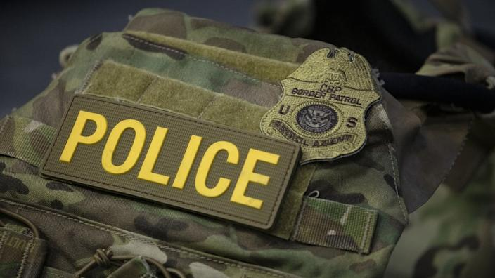 A protective vest with identifying markings worn by US federal agents in Portland is displayed during a press conference