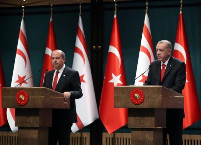Turkish President Erdogan and Turkish Cypriot leader Tatar attend a news conference in Ankara