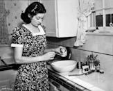 <p>The <em>I Love Lucy </em>star bakes in her Los Angeles kitchen.</p>