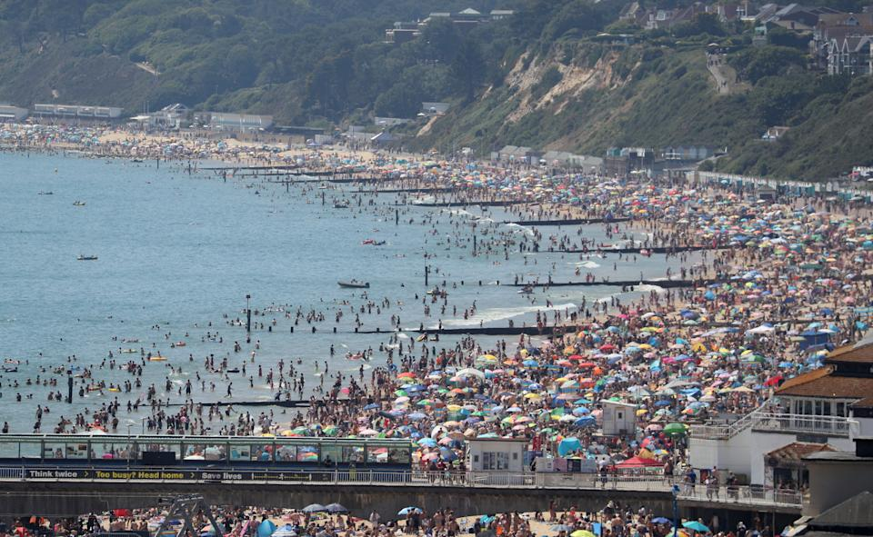 Crowds gather on the beach in Bournemouth as Thursday could be the UK's hottest day of the year with scorching temperatures forecast to rise even further. (Photo by Andrew Matthews/PA Images via Getty Images)