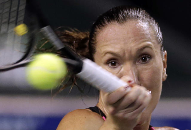 Serbia's Jelena Jankovic returns the ball against Eugenie Bouchard of Canada during their third round match of the Pan Pacific Open tennis tournament in Tokyo, Wednesday, Sept. 25, 2013. (AP Photo/Shizuo Kambayashi)