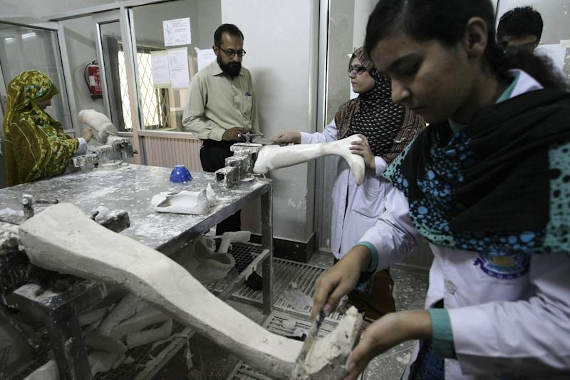 In this picture taken on Saturday, March 30, 2013, Pakistani female doctors working on dies to cast prosthetic limbs at the Dow Medical Institute for Health in Karachi, Pakistan. In a country better known for honor killings of women and low literacy rates for girls, Pakistan's medical schools are a reflection of how women's roles are evolving. Women now make up the vast majority of students studying medicine, a gradual change that's come about after a quota favoring male admittance into medical school was lifted in 1991. (AP Photo/Fareed Khan)