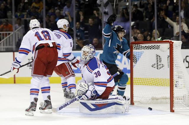 New York Rangers' Henrik Lundqvist (30), of Sweden, is beaten for a goal by San Jose Sharks' Marc-Edouard Vlasic, not seen, during the first period of an NHL hockey game Tuesday, Oct. 8, 2013, in San Jose, Calif. (AP Photo/Marcio Jose Sanchez)