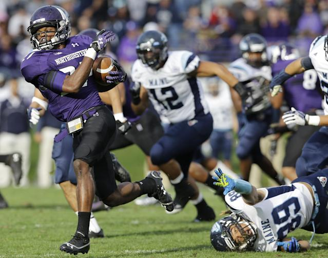 Northwestern corner back Matthew Harris (27) runs with the ball past Maine wide receiver Arthur Williams (89) during the second half of an NCAA college football game in Evanston, Ill., Saturday, Sept. 21, 2013. Northwestern won 35-21. (AP Photo/Nam Y. Huh)