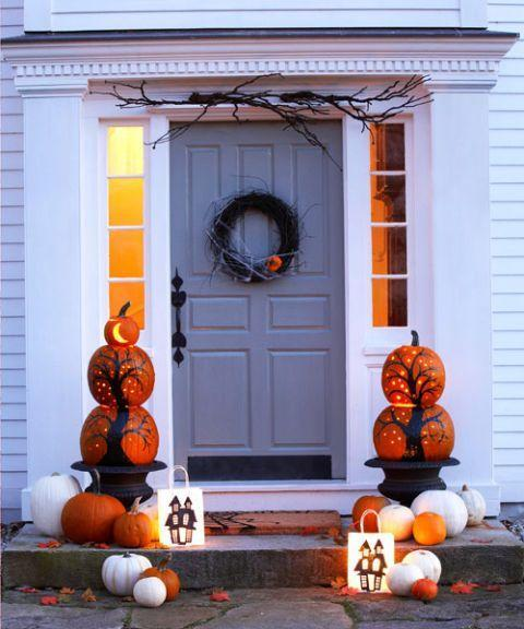 "<p>Pumpkin pillars, glowing luminaries, and a grapevine wreath deck out this entry. Short on time? Stick some gnarly branches on top of the doorframe for instant impact.</p><p>Get the tutorial at <em><a href=""http://www.goodhousekeeping.com/holidays/halloween-ideas/g1566/easy-halloween-craft-ideas/"" rel=""nofollow noopener"" target=""_blank"" data-ylk=""slk:Good Housekeeping"" class=""link rapid-noclick-resp"">Good Housekeeping</a>.</em></p>"
