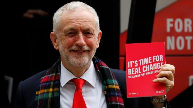 Leader of the Labour Party Jeremy Corbyn holds his party's general election manifesto at its launch in Birmingham, Britain November 21, 2019.