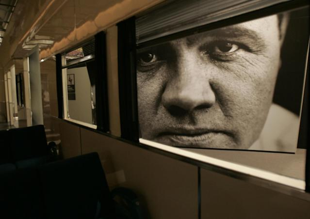 FILE - This May 13, 2005 file photo shows a large photograph of Babe Ruth used for an exhibit at the Sports Legends at Camden Yards museum in Baltimore. There are many destinations of interest to baseball fans around the country outside ballparks from museums and statues to historic homes. (AP Photo/Chris Gardner, File)