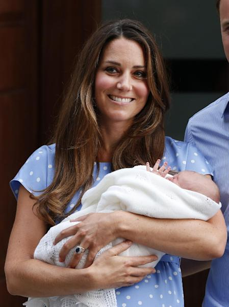 Kate, Duchess of Cambridge holds the Prince of Cambridge, Tuesday July 23, 2013, as she poses for photographers outside St. Mary's Hospital exclusive Lindo Wing in London where the Duchess gave birth on Monday July 22. The Royal couple are expected to head to London's Kensington Palace from the hospital with their newly born son, the third in line to the British throne. (AP Photo/Lefteris Pitarakis)