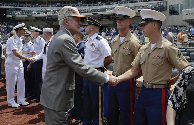 United States Sec. of the Navy Ray Mabus greets United States Marines before the start of a baseball game between the New York Mets and Pittsburgh Pirates, Monday, May 26, 2014, in New York. Military personnel from the U.S. Army, Navy, Air Force, Marine Corps and Coast Guard were honored before the game in recognition of Memorial Day. (AP Photo/Julie Jacobson)