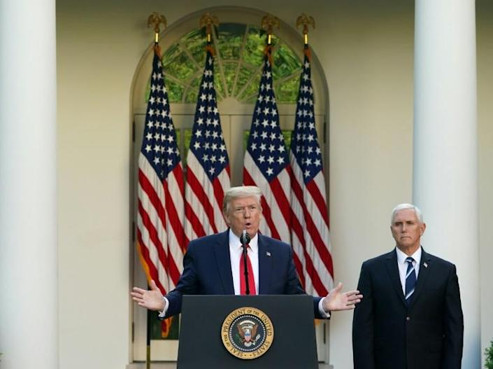 US President Donald Trump speaks as US Vice President Mike Pence and other senior White House officials have pointedly ignored advice to wear masks, leading to speculation it is a coordinated decision to downplay the severity of the crisis. (AFP Photo/MANDEL NGAN)