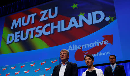 FILE PHOTO: Frauke Petry, chairwoman of the anti-immigration party Alternative for Germany (AfD), and AfD leader Joerg Meuthen sing at the end of the second day of the AfD congress in Stuttgart, Germany, May 1,  2016. REUTERS/Wolfgang Rattay /File Photo