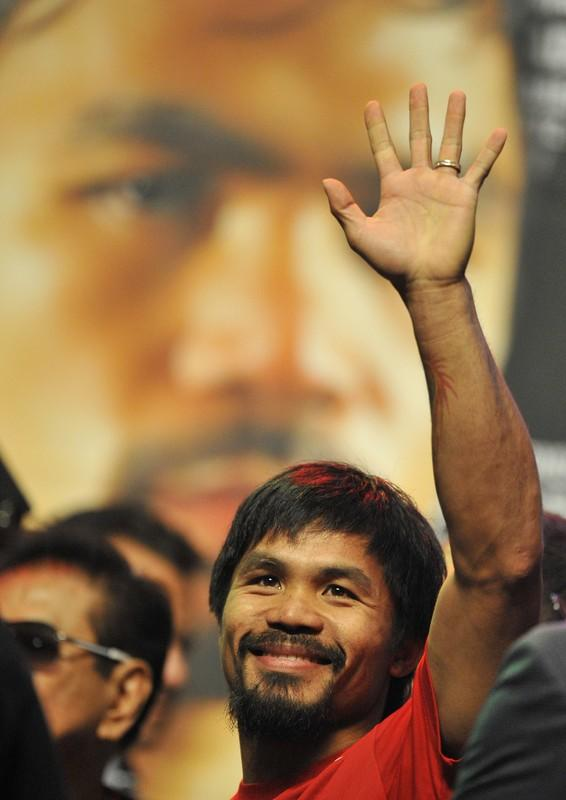Manny Pacquiao of the Philippines greets his fans during weigh-in at the MGM Grand Arena in Las Vegas, Nevada on June 08,2012.  Pacquiao and Bradley will fight on June 9.      AFP PHOTO / JOE KLAMARJOE KLAMAR/AFP/GettyImages